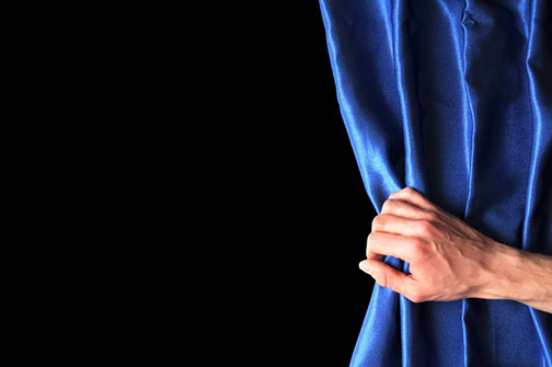 invest in your future concept with blue curtain hand and black background